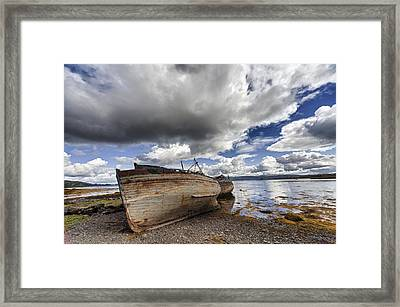 Weathered Boats Abandoned At The Waters Framed Print by John Short
