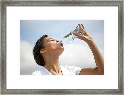 Woman Drinking Bottled Water Framed Print by