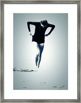 Woman Emerging Framed Print by Brian D Meredith