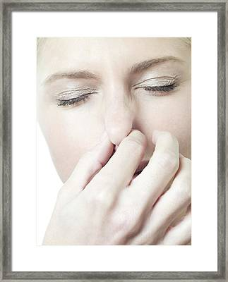 Woman Holding Her Nose Framed Print by