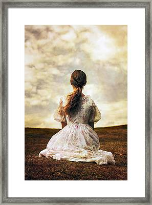 Woman On A Meadow Framed Print