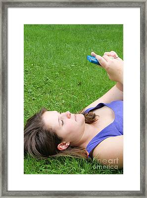 Woman Using Her Iphone Framed Print