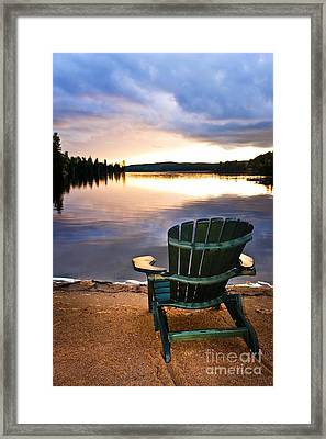 Wooden Chair At Sunset On Beach Framed Print