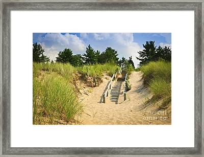 Wooden Stairs Over Dunes At Beach Framed Print