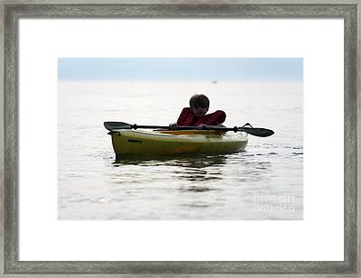 Young Boy Paddling Kayak Framed Print by Christopher Purcell