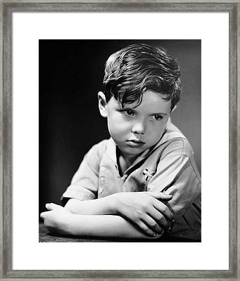 Young Boy Pouting Framed Print by George Marks