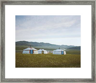 Yurts On The Wide Grassy Plains Of Mongolia Framed Print