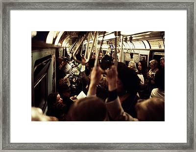 1970s America. Passengers On A Subway Framed Print by Everett