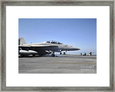 A Shooter Signals The Launch Of An Framed Print by Stocktrek Images