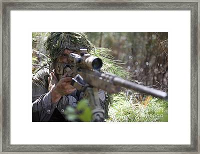 A Sniper Sights In On A Target Framed Print by Stocktrek Images