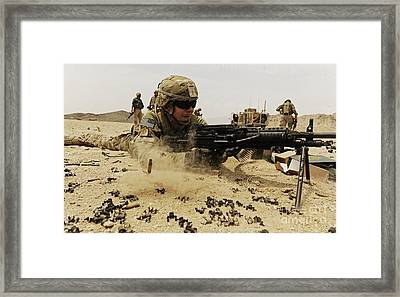 A Soldier Firing His Mk-48 Machine Gun Framed Print by Stocktrek Images