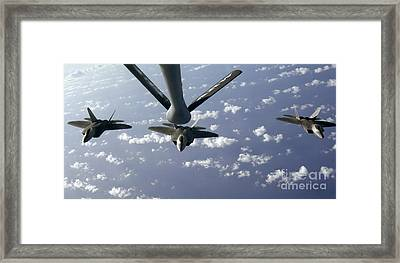 A Three Ship Formation Of F-22 Raptors Framed Print by Stocktrek Images