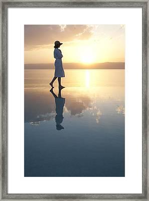 A Woman Enjoys The Warm Sun On The Edge Framed Print by Taylor S. Kennedy