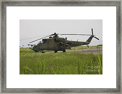An Mi-35 Attack Helicopter At Kunduz Framed Print by Terry Moore