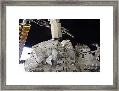 Astronauts Working On The International Framed Print