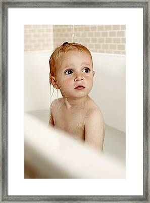 Bathing Child Framed Print by Ian Boddy