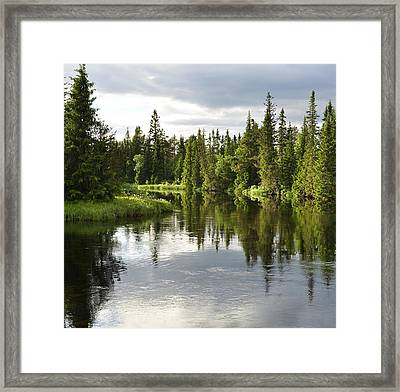 Calm Lake Reflection Framed Print by Conny Sjostrom
