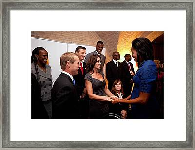 First Lady Michelle Obama Greets Framed Print by Everett