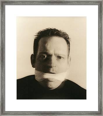 Gagged Man Framed Print by Cristina Pedrazzini