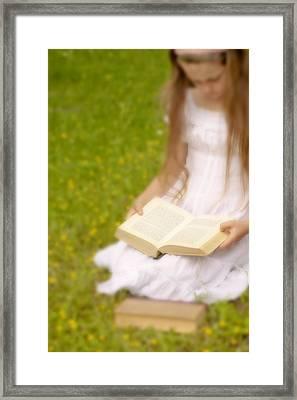 Girl Is Reading A Book Framed Print by Joana Kruse