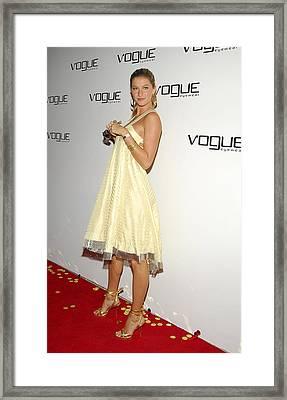 Gisele Bundchen At Arrivals For Vogue Framed Print by Everett
