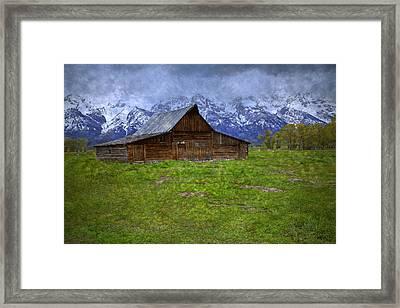 Grand Teton Iconic Mormon Barn Spring Storm Clouds Framed Print by John Stephens