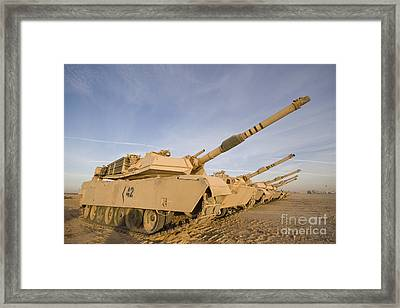 M1 Abrams Tanks At Camp Warhorse Framed Print by Terry Moore