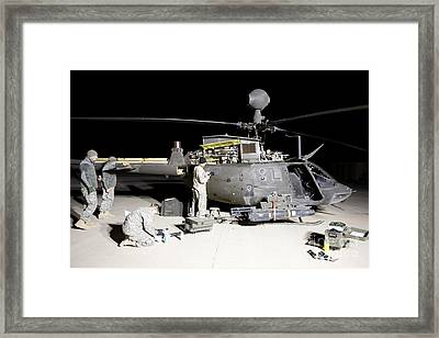 Maintenance Crew Works On Servicing Framed Print by Terry Moore