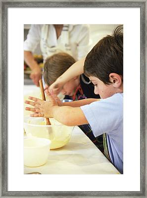 Making Cakes Framed Print by Veronique Leplat