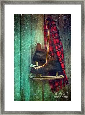 Old Ice Skates Hanging On Barn Wall Framed Print by Sandra Cunningham