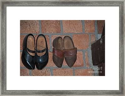Old Wooden Shoes Framed Print by Carol Ailles