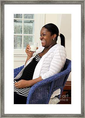 Pregnant Woman Drinking Milk Framed Print by Photo Researchers