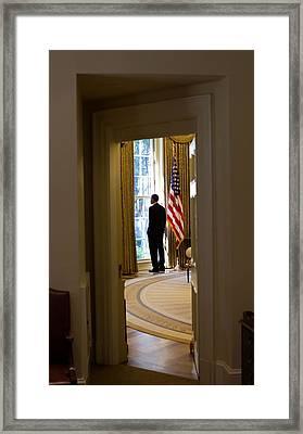 President Barack Obama Looks Framed Print