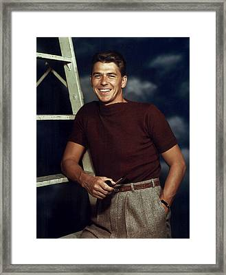 Ronald Reagan In The 1940s Framed Print by Everett
