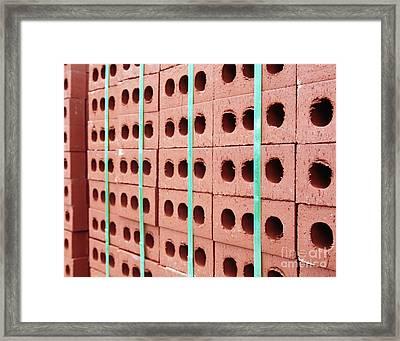 Stack Of Red Bricks Bound Together Framed Print
