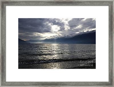 Sunlight Over A Lake Framed Print