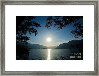 Sunshine Over An Alpine Lake Framed Print