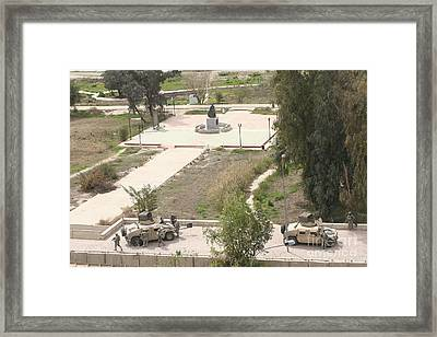 U.s. Military Soldiers Take A Well Framed Print by Terry Moore