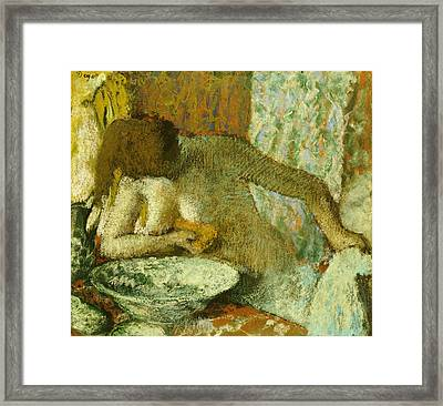 Woman At Her Toilet Framed Print by Edgar Degas