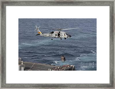 A Sh-60j Seahawk Conducts A Vertical Framed Print