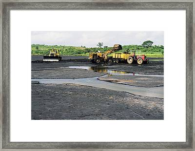 Asphalt Lake Framed Print by David Nunuk