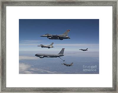 Four F-16s And A Kc-135 Fly Framed Print