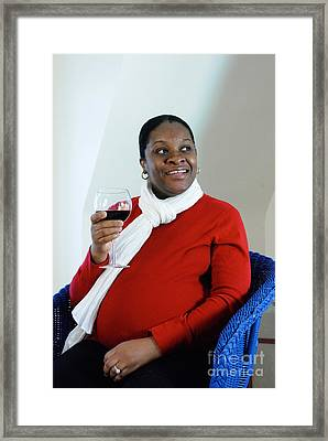 Pregnant Woman Drinking Wine Framed Print by Photo Researchers