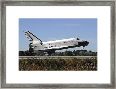 Space Shuttle Atlantis Touches Framed Print by Stocktrek Images