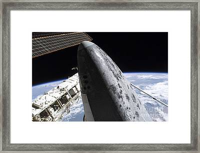 Space Shuttle Discovery Docked Framed Print by Stocktrek Images