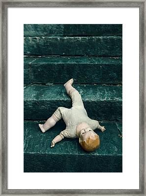 The Doll Framed Print