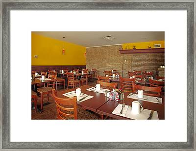 The Interior Of A Restaurant Framed Print by Charles Knox