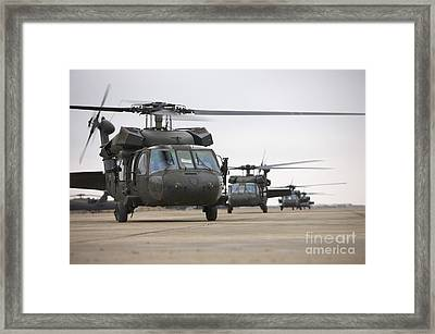 Uh-60 Black Hawks Taxis Framed Print by Terry Moore