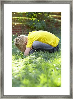 Unhappy Boy Framed Print
