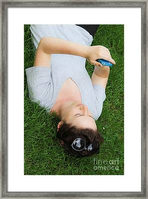 Woman Using Her Iphone Framed Print by Photo Researchers, Inc.